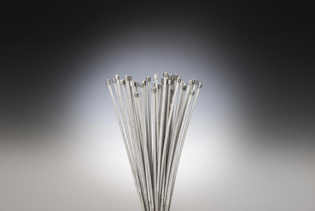 Plastic coated cable assembly with ferrule
